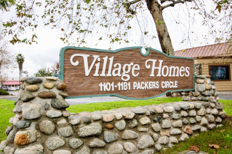 Attractive entrance adornment greets visitors at the Village Homes community