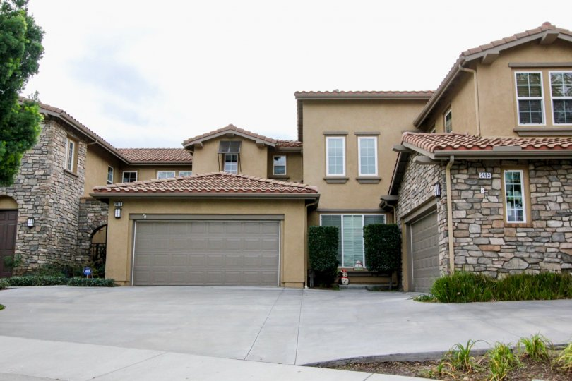 tan home with brick garage in canterbury community in yorba linda, california.