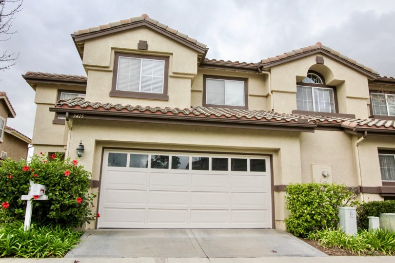 Beautiful home front with attached garage and red flowers in La Terraza I community, in Yorba Linda, California