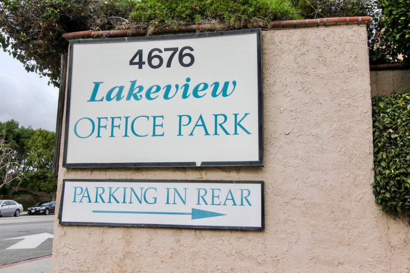 Address board of the Lakeview is attached in the wall of the entrance with bushes and trees