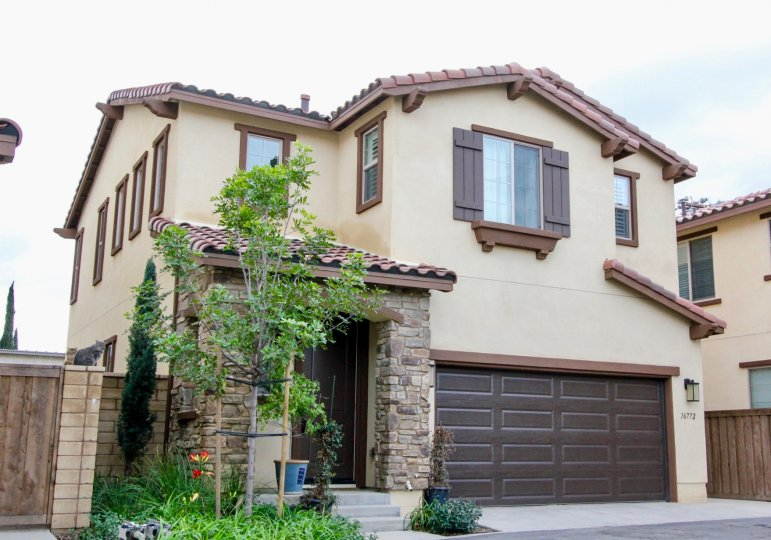 Tall house with brown windows in Rouse Court, Yorba Linda California