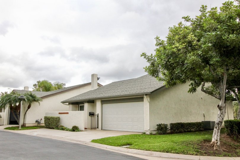 Woodgate Yorba Linda California with attractive grey color road and roof with grass fields