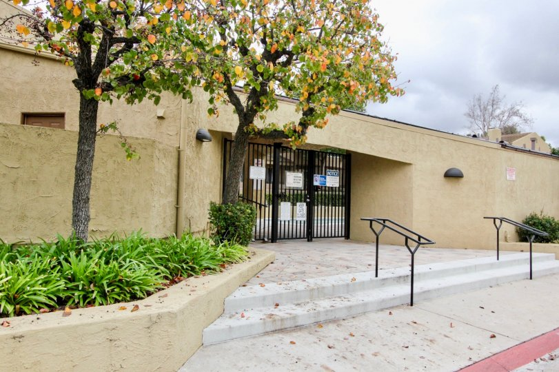 Gated entrance with stairs at Yorba Linda Knolls in Yorba Linda, California on a crisp, fall, day.