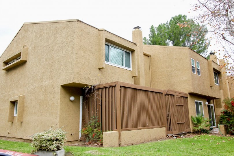 Brown residential housing with large windows and great privacy in the community Yorba Linda Knolls.