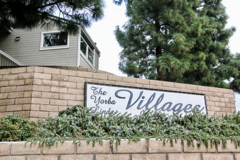 A large villa with the Yorba Linda villages community name inscribed on its compound