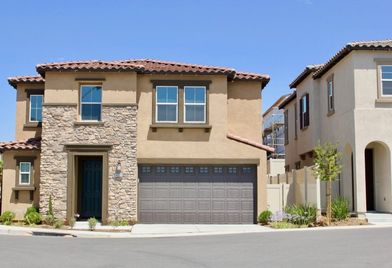 Front of adobe style house in the Seneca community in Murrieta California