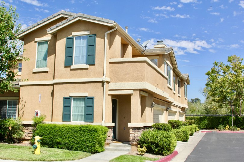Side view of one of the apartment buildings at Villas at Old School house in Murrieta CA.