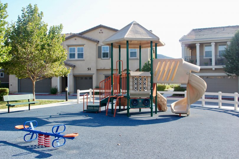 A sunny day in the Bel Vista with children's playarea and seats.