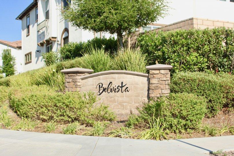 Bel Vista is written in a fancy font on a wall at the Bel Vista community.
