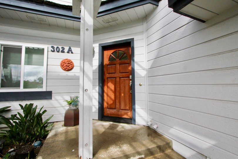 A sunny day in the area of 302 Hemlock, front door, outside, condo, potted plant, window