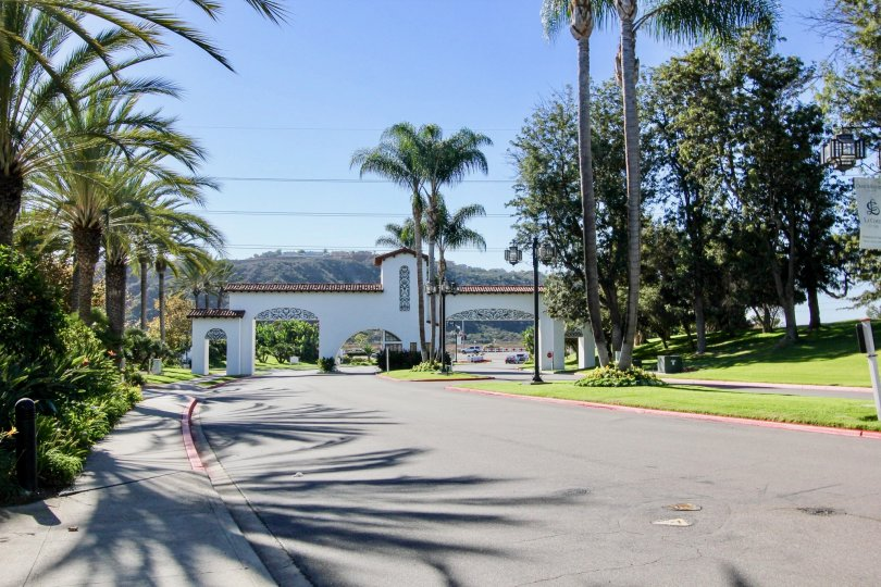 Sunny day with beautiful view of trees and garden with entrance in Balboa Building of Carlsbad