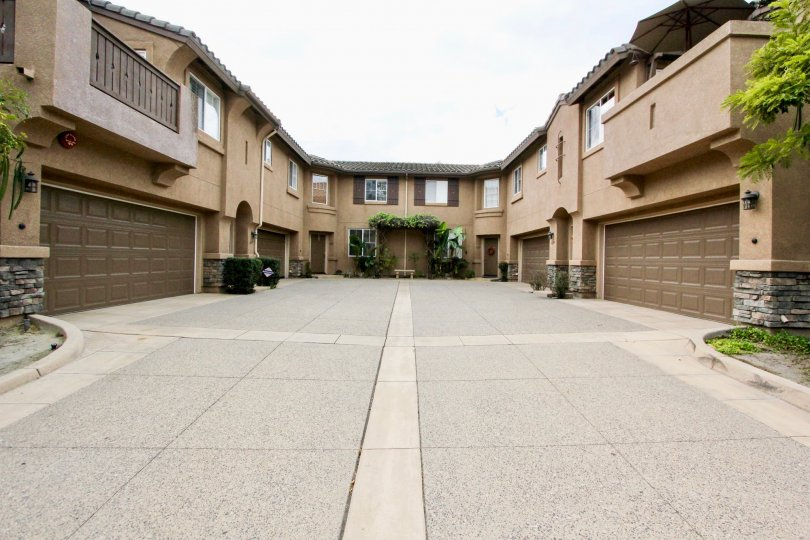 A two-storey townhouse with a center driveway in Brindisi neighborhood.