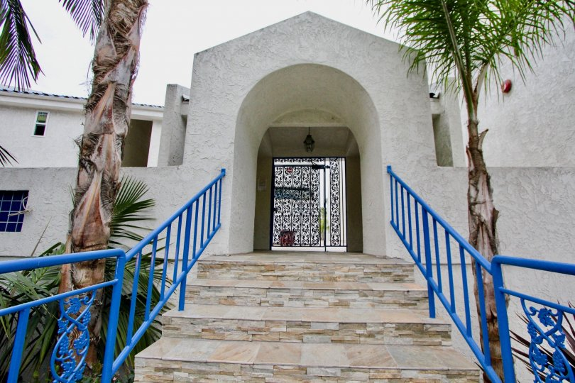 An arched gateway with blue railings in the Bristol Cove neighborhood.