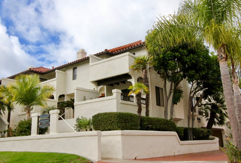 An outside view of Carlsbad Beach Villas apartments.