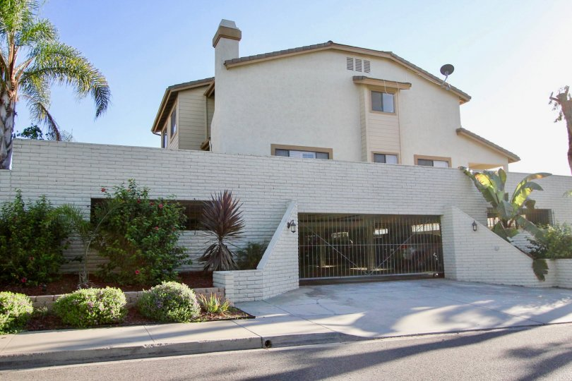 A gated residence in the Centalla Meadows community of Carlsbad California on a sunny day.
