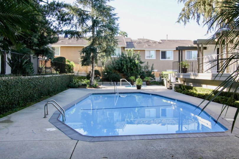 A small pool is surrounded by a black gate at the Costa Verde community of Carlsbad, California.