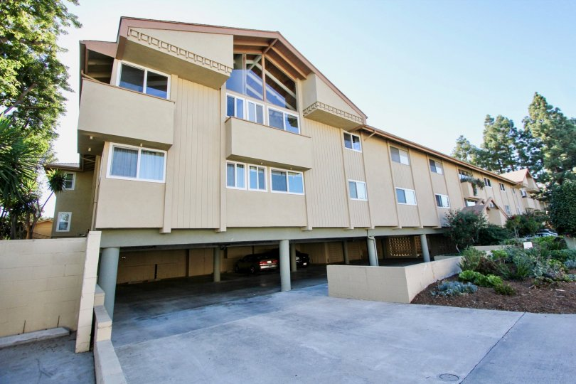 Building with a parking lot below it in the Fairview Community in Carlsbad, CA.