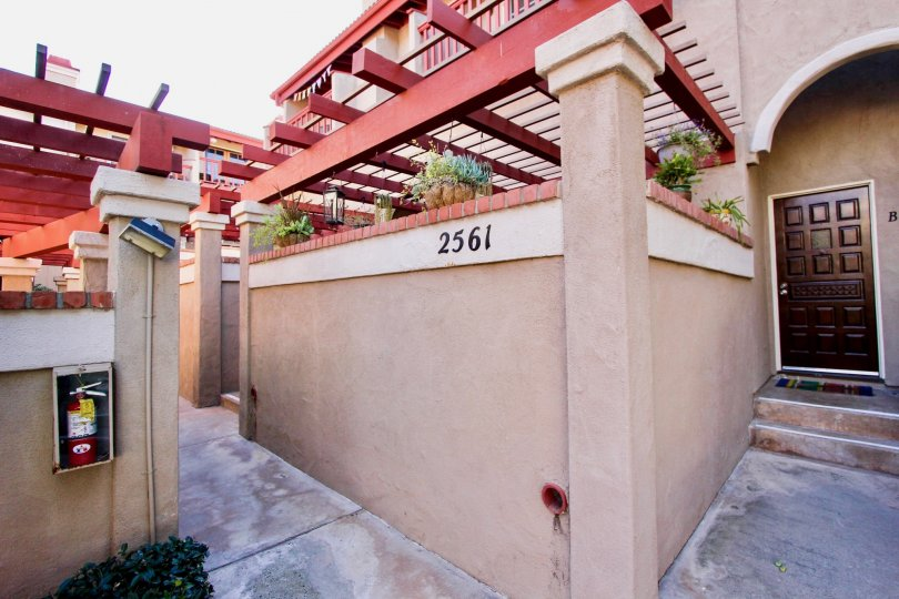 THE 2561 APARTMENT IN THE FAIRWAYS SOUTH WITH THE FIRESAFETY, [LANTS, FLOWER POTS, WOODEN DOOR