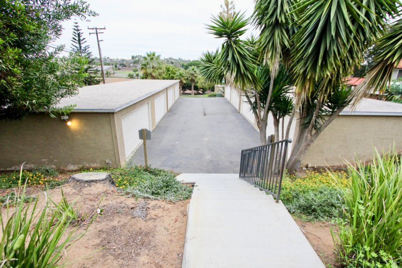 Nice approach of villa with maingate with trees in Highland Townhomes of Carlsbad