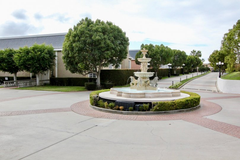 A bright day in the Jockey Club with water fall and trees.