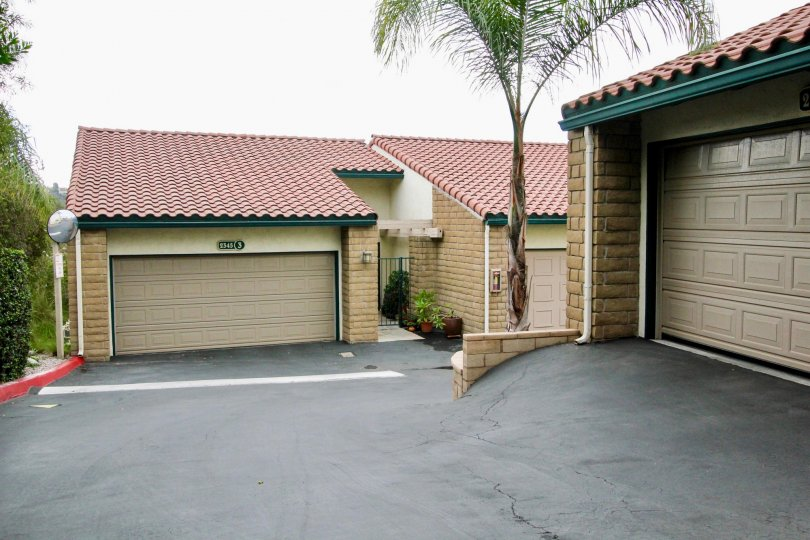 Condominiums with garages on an overcast day in the community of La Costa Del Sol in Carlsbad CA