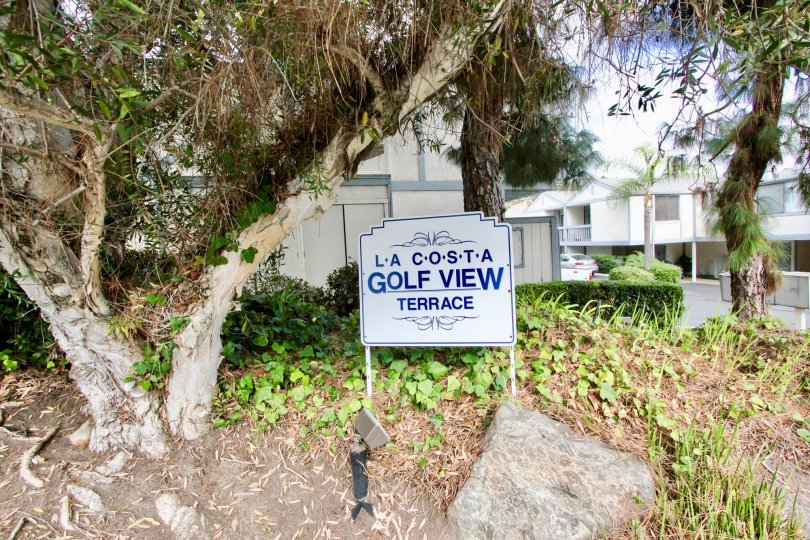 Villas with awesome trees and road sign in La Costa Golf view of Terrace in Carlsbad