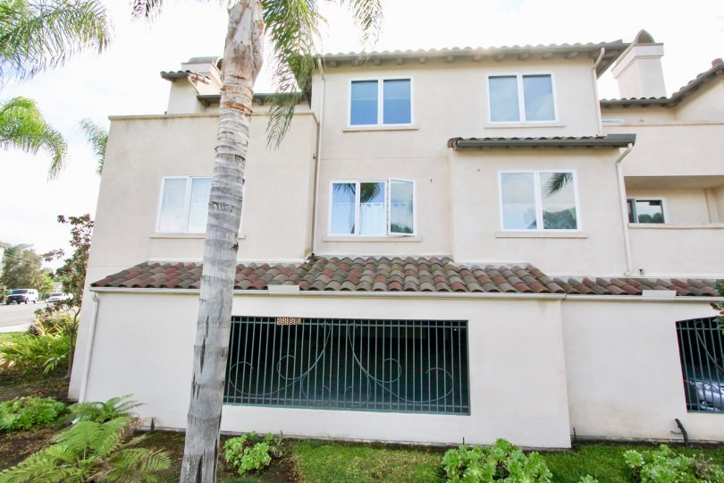 This multilevel Laguna Point home boasts lots of windows and wrought iron touches.