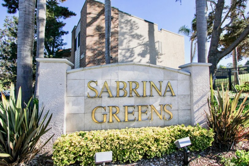 Nice villa with signboard and trees on a sunny day in Sabrina Greens of Carlsbad
