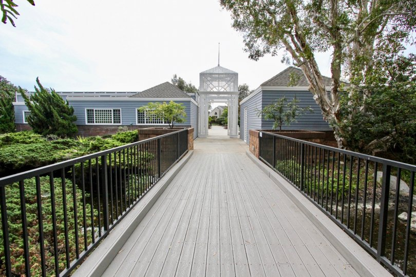 THE HOUSE IN THE SEA CLIFF WITH THE TREES, PLANTS, PATHWAY WITH STEEL GATE