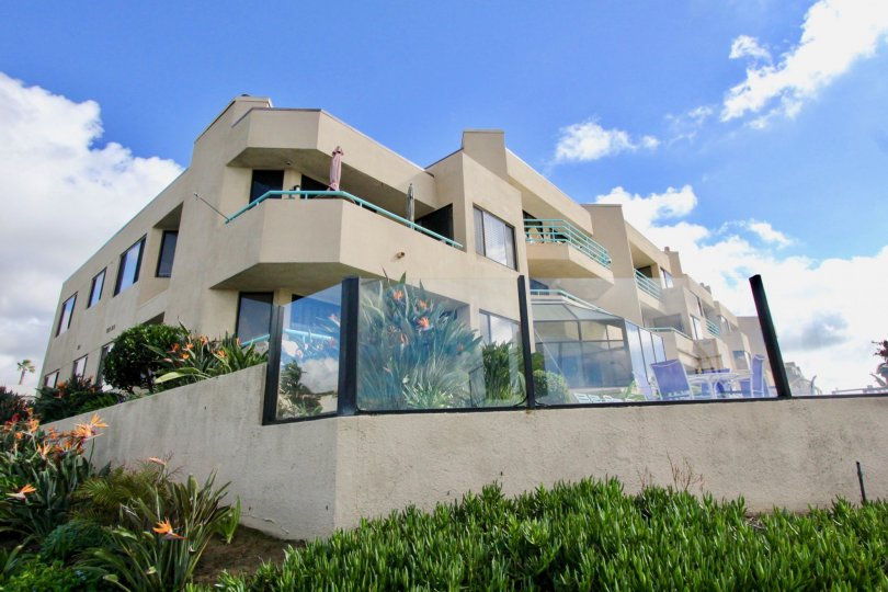 A two story building filled with condos inside Tamarack Shores in Carlsbad CA