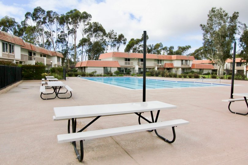 Swimming pool and many tables placed in Tanglewood community of city Carlsbad