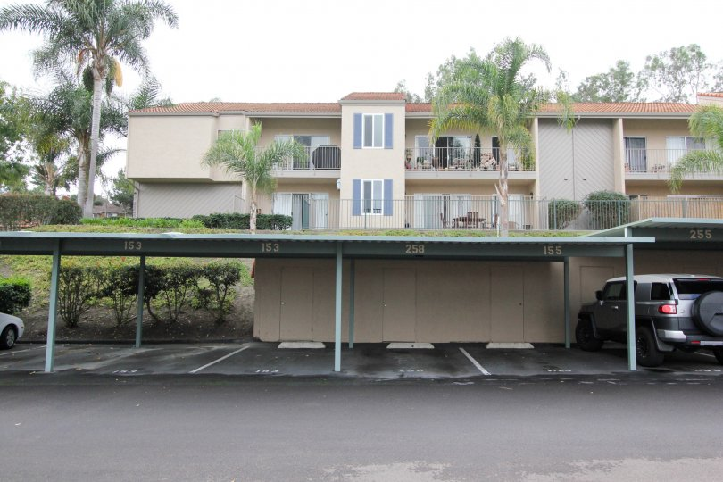 A line of covered parking spaces below The Grove homes in Carlsbad CA