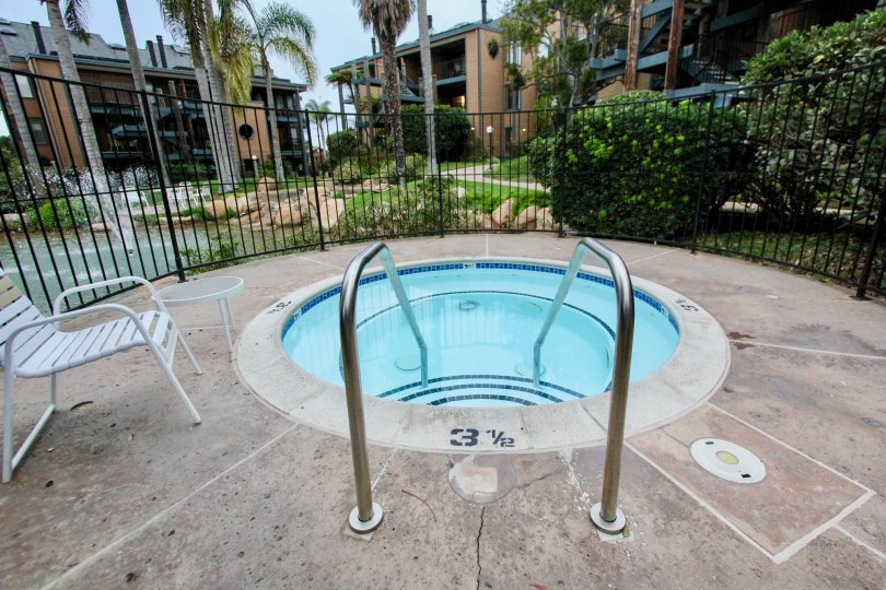 A hot tub is featured at Windsong Cove, with a bubbling water feature nearby.