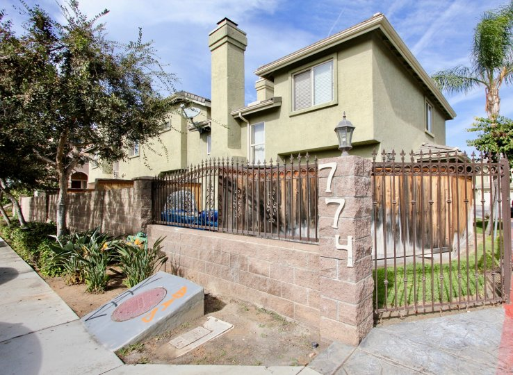 Gated property at 774 in Ada Terrace with chimney and satellite television.