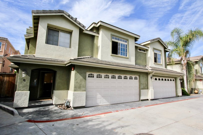 Two story housing with large white garage doors located at Ada Terrace in Chula Vista CA
