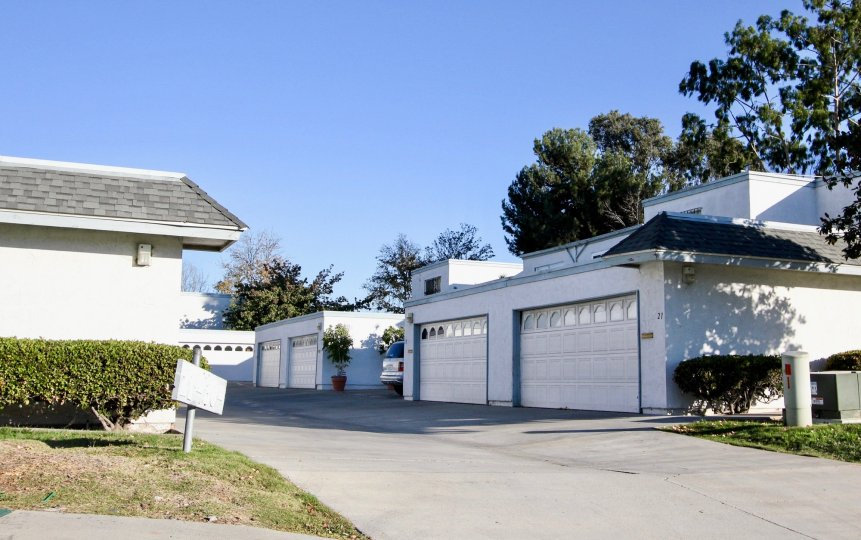 Blue sky and a driveway with garages in the Autumn Hills Community in Chula Vista, CA.