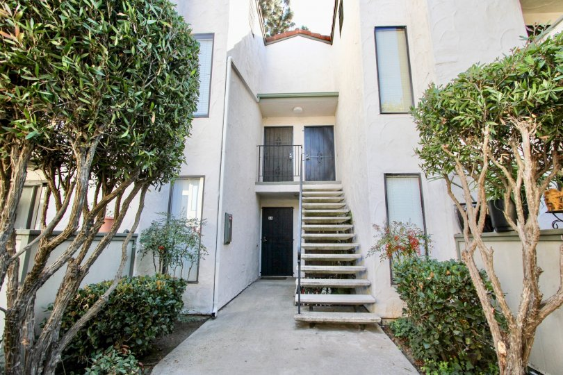 Stairwell to second-floor apartment at Brentwood Arms in Chula Vista, CA