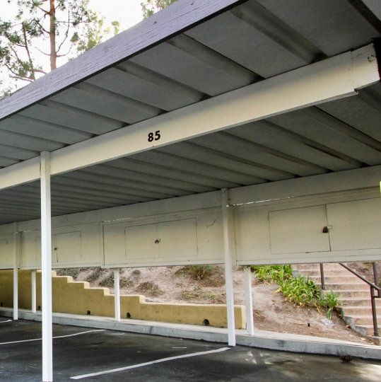 Covered carport with locking overhead storage area at Camelot community in Chula Vista, California