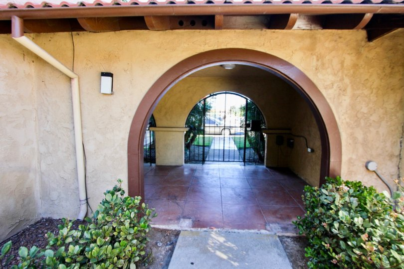 Interior view of the entry with large arches and secure gate door at Casa de Moss