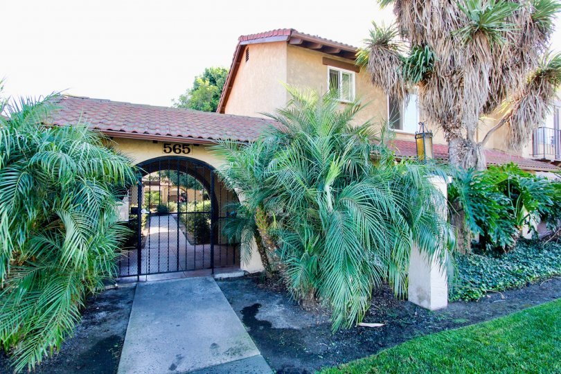 Secure gated entry with landscaping features in Chula Vista