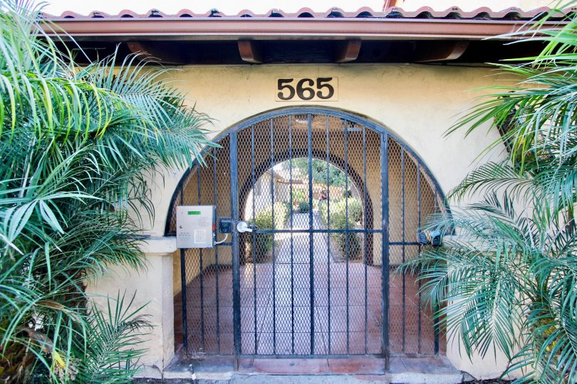 A gate to an alley of a residence 565 in Casa de Moss
