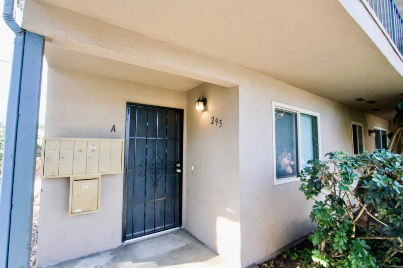 The outside of a Casa Verse Home in Chula Vista by the front door and above a balcony
