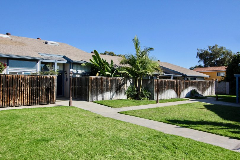 A bright green lawn in front of a fenced building in Chula Vista, CA