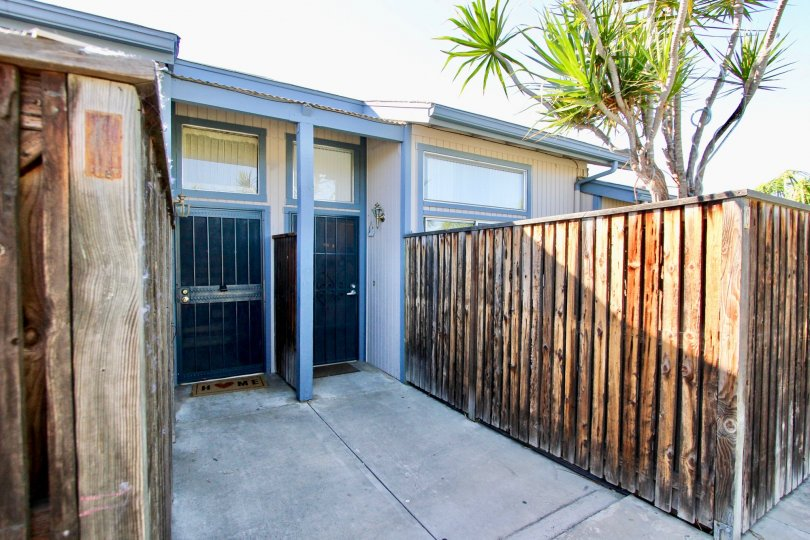 Security screen doors with high privacy wooden fences at Casa Vianney