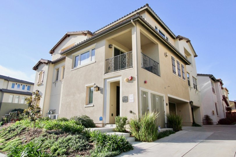 Inviting exterior view of the Clover community on a sunny day in Chula Vista, CA