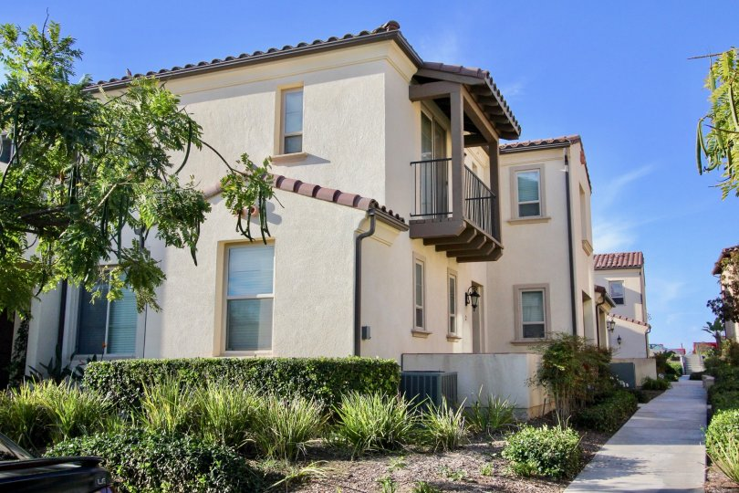 A two story white & brown residential building in Chula Vista CA at Cordova