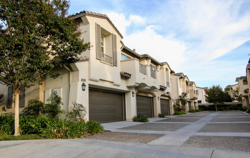 Driveway with large stone paved squares inside the Cortina at Chula Vista CA