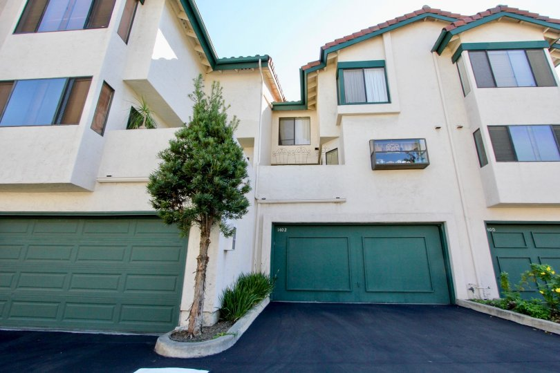 Three garage doors at the bottom of town homes in Eucalyptus Ridge in Chula Vista CA