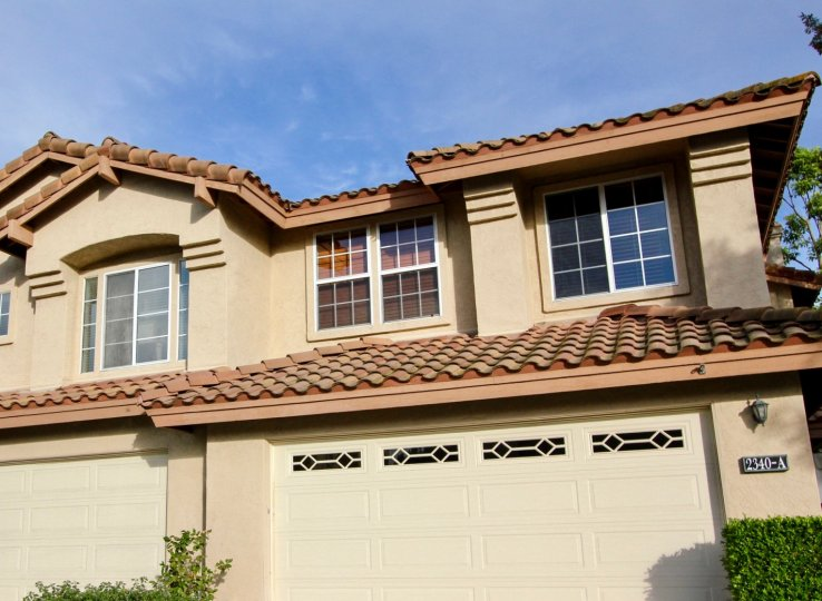 Terracotta tiled roofline with plenty of window and private garages at the Fairway Villas in Chula Vista, California