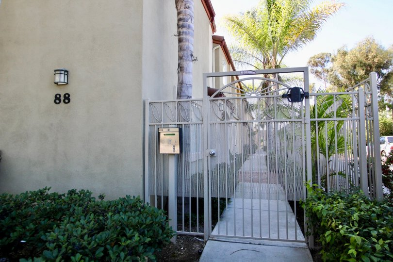 Locked entrance gate with call box at 88 Fourth Park Place, Chula Vista, CA.